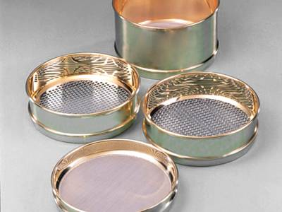 Four working sieves on the white background with different height and opening.